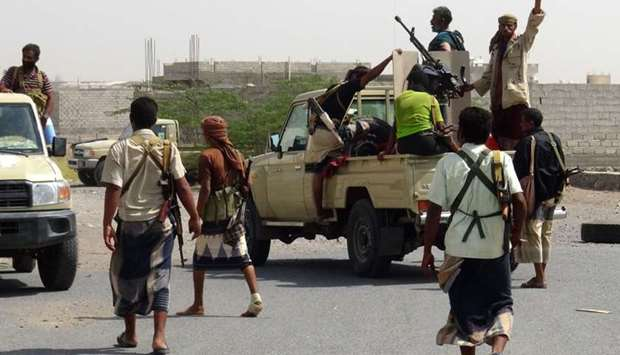 Yemeni pro-government forces gather on the eastern outskirts of Hodeidah as they continue to battle