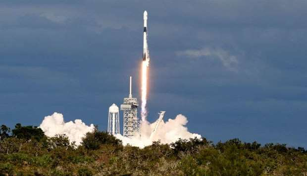 A SpaceX Falcon 9 rocket launches Qatar's Es'hail-2 communications satellite from Launch Pad 39A at