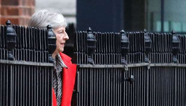 Britain's Prime Minister Theresa May leaves 10 Downing Street via the back exit in London. Reuters