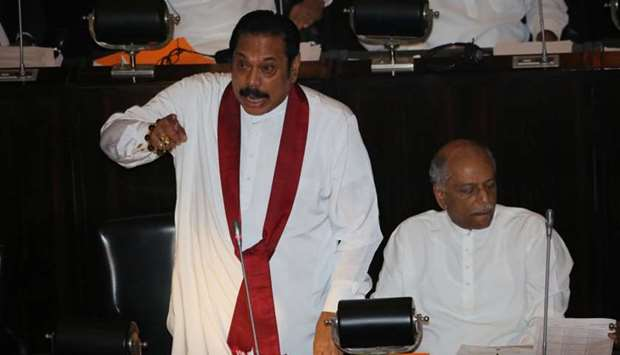 Sri Lanka's newly appointed Prime Minister Mahinda Rajapaksa speaks during the parliament session in