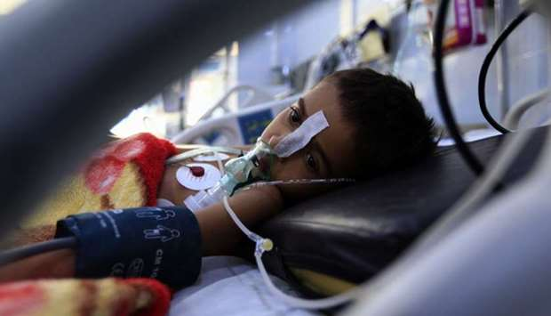 A Yemeni child suffering from a diphtheria infection receives treatment at a hospital in the capital