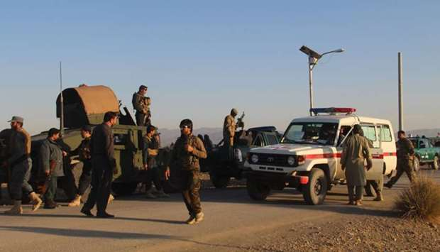 Afghan security force arrive near the site after a suicide bomber blew himself up inside a packed mo