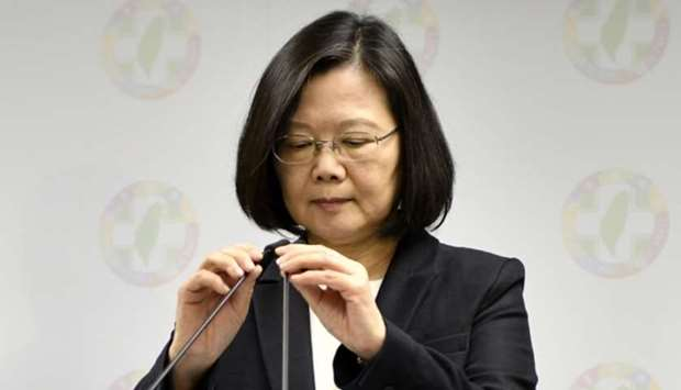 Taiwan President Tsai Ing-wen (C) adjusts a microphone during a press conference