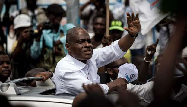 Martin Fayulu (C) waves to supporters from a car