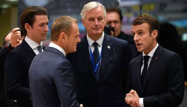 France's President Emmanuel Macron (R) chats with EU chief Brexit negotiator Michel Barnier (C), Aus