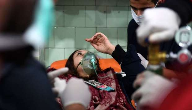 A Syrian woman receives treatment at a hospital in the regime controlled Aleppo