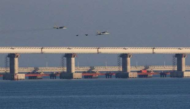 Russian jet fighters fly over a bridge connecting the Russian mainland with the Crimean Peninsula af