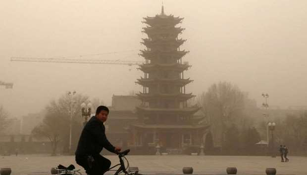 A cyclist riding in a sandstorm in Zhangye, in China's northwestern Gansu province
