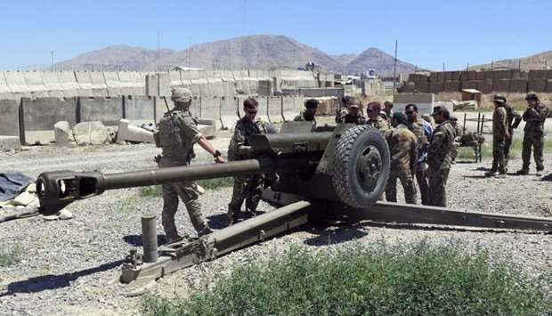 US military advisers work with Afghan soldiers at an artillery position on an Afghan National Army b