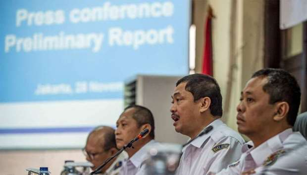 Indonesia's National Transportation Safety Commission's (KNKT) deputy head Haryo Satmiko (2nd R) del