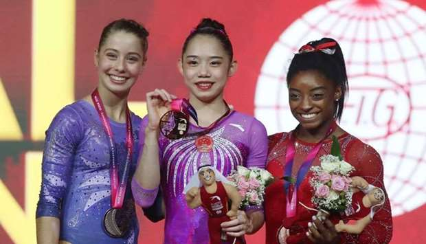 (From L) Canada's Anne-Marie Padurariu (silver), China's Liu Tingting (gold) and US Simone Biles (br