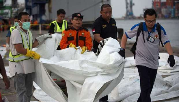 Officials transfer recovered debris from the ill-fated Lion Air flight JT 610 for further examinatio