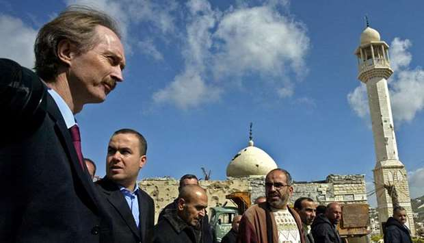Geir Pedersen (L) walks alongside Hezbollah deputy Hassan Fadlallah (2nd L) and other officials