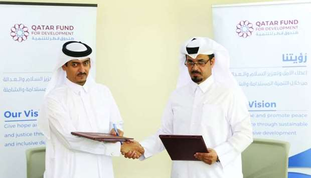(From left) QFFD executive director for shared services Mansoor Abdullah al-Dehaimi and QRCS executi