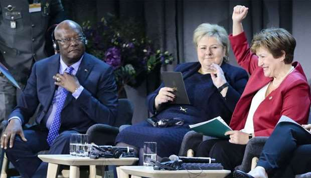 The President of Burkina Faso, Roch Marc Christian Kaboré (L), Norway´s Prime Minister Erna Solberg