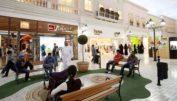 Visitors wait on benches outside retail stores at Villaggio Mall in Doha (file). More than 40% of or
