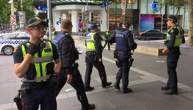 Policemen stop members of the public from walking towards the Bourke Street mall in central Melbourn