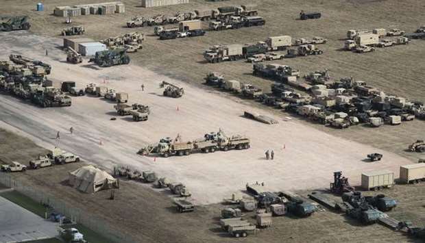 US Army vehicles sit parked at a new military camp under construction at the US-Mexico border