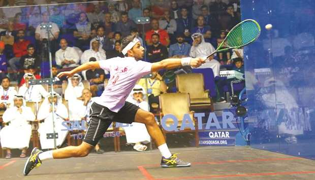 Abdulla al-Tamimi stretches to meet the ball during his second round match against Mathieu Castagnet