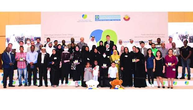 HE Dr Hanan Mohamed al-Kuwari, Minister of Public Health and HMC officials with the organ  donors
