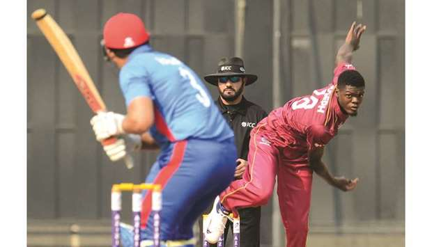 West Indies' Alzarri Joseph (right) bowls to Afghanistan's Hazratullah Zazai during the third ODI at