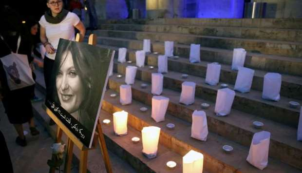 A photo of the British embassy worker, Rebecca Dykes, is seen during a candlelight sit-in organised