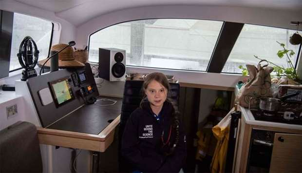 Swedish climate activist Greta Thunberg speaks to AFP during an interview aboard La Vagabonde, the b