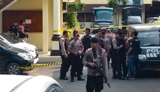 Indonesian police secure their headquarters in Medan, North Sumatra