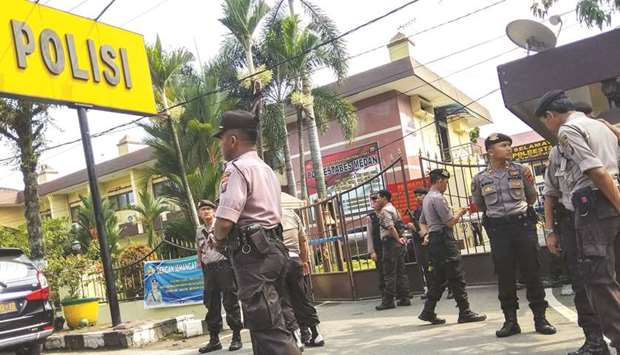 Police secure their headquarters in Medan, North Sumatra, yesterday, after a suicide attack occurred