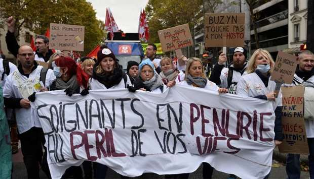 French hospitals and health workers on strike attend a demonstration urging the French government to