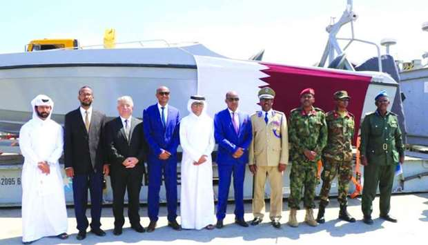 Somali and Qatari officials on the occasion of handing over of Qatari donation - boats and machinery