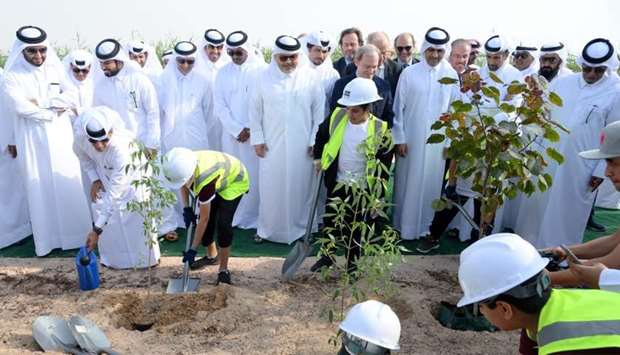 Dignitaries with schoolchildren during the tree-planting exercise. PICTURE: Thajudheen