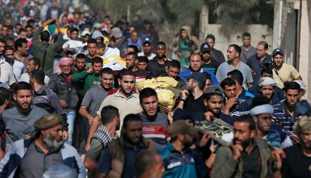 Palestinians attend the funeral procession of members of the same family who were killed overnight i