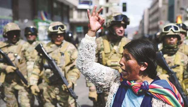 A Bolivian indigenous woman, a supporter of Bolivian ex-president Evo Morales, gestures in front of