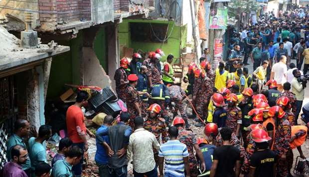 Rescue workers are seen at the site of a gas pipeline explosion in the port city of Chittagong