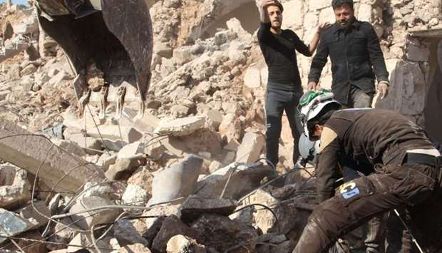 """Syrian Civil Defence, also known as the """"White Helmets"""", rescue from the rubble a body of a person k"""