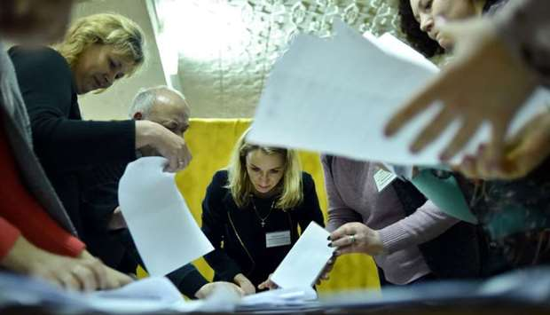Members of a local electoral commission, Belarus, count votes at a polling station after the Belarus