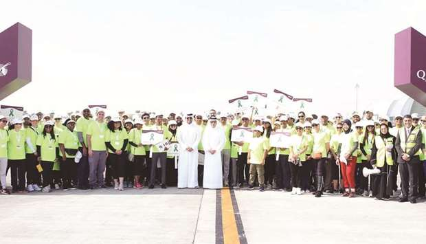 HE Akbar al-Baker with Badr Mohamed al-Meer and the participants at the start of the walk.