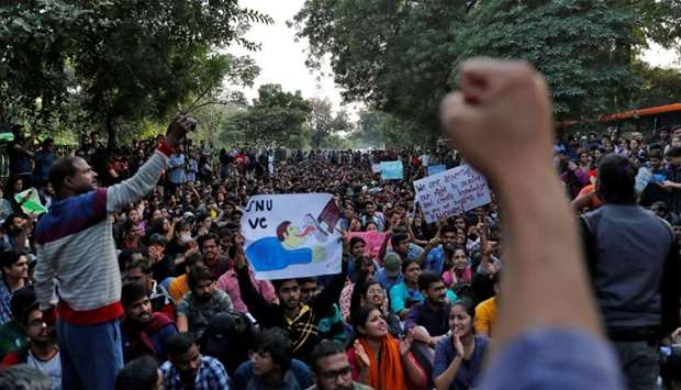 Students of Jawaharlal Nehru University shout slogans during a protest against a proposed fee hike,