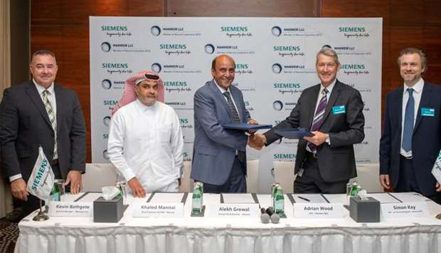 Siemens and Mannai officials after signing the agreement.