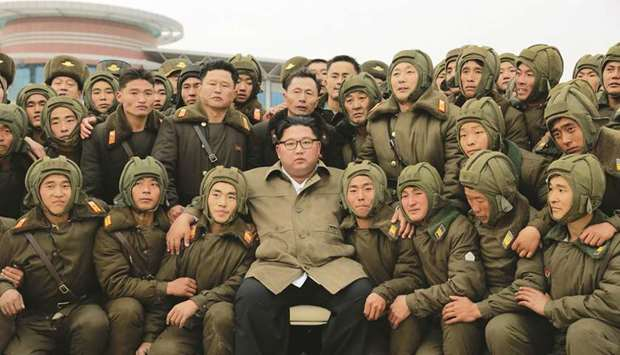 North Korean leader Kim Jong-un posing with members of the Air and Anti-Aircraft Force of the Korean