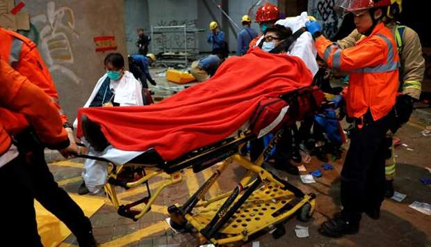 Protesters wait to receive medical attention at the Hong Kong Polytechnic University campus during p