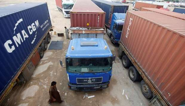 Trucks are jammed at the Umm Qasr port, as demonstrators block the entrance during the ongoing anti-