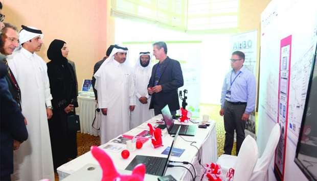 Kahramaa president Essa bin Hilal al-Kuwari during a tour of the '2nd Conference on Smart Grid and R