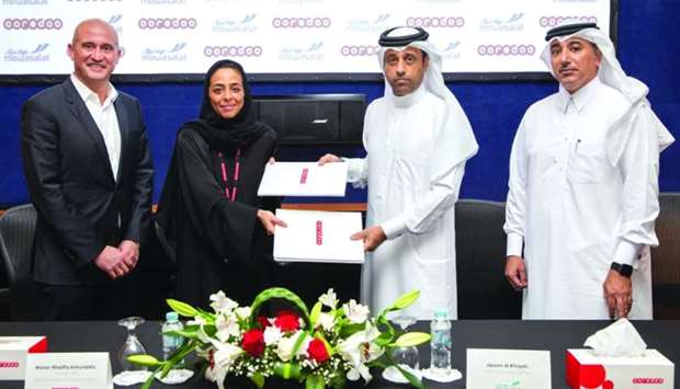 Ooredoo director of PR and Corporate Communications Manar Khalifa al-Muraikhi and Mowasalat Qatar ch
