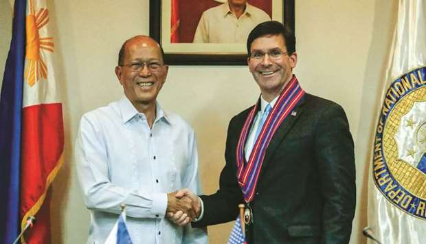 US Defence Secretary Mark Esper shakes hands with his Philippine counterpart Delfin Lorenzana during