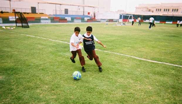 The photographs and stories show the intimate realities of Qatari football culture from the perspect
