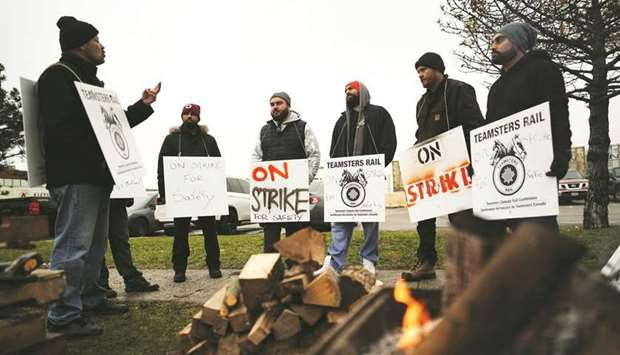 Teamsters Canada union workers picket at the Canadian National Railway Terminal in Brampton, Ontario