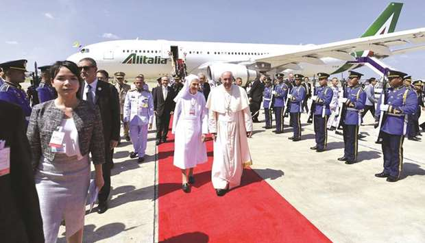 Pope Francis arrives at a military air terminal in Bangkok yesterday.