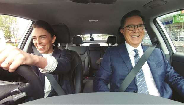 New Zealand PM Jacinda Ardern drives US talk show host Stephen Colbert after picking him up from the